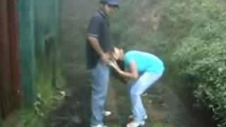 Indian college girl giving her boyfriend a blowjob in rain