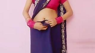 Young Indian girl teaching how to wear a saree